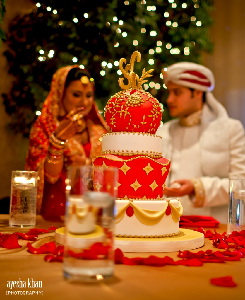The bride and groom Sana and Shahzeb with their wedding cake The Muslim Bride 837x1024 The Muslim Bride Special Wedding Feature: Sana and Shahzebs Wedding Reception