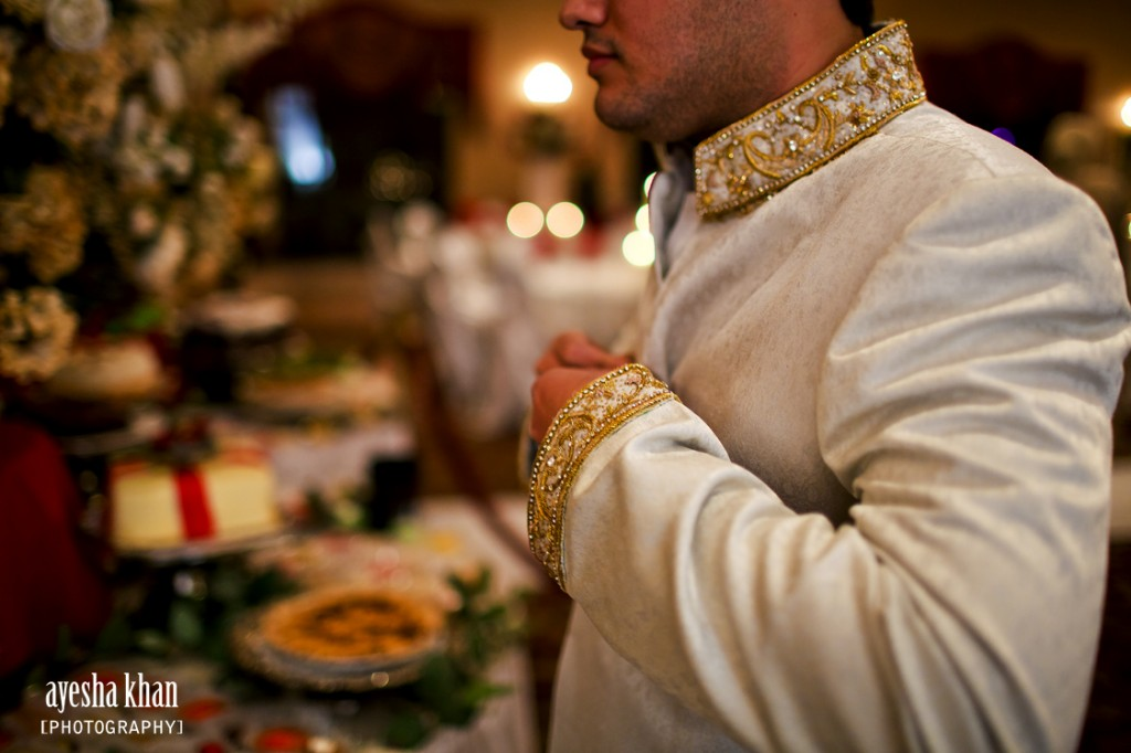 The groom Shahzeb fixing his sherwani The Muslim Bride  1024x682 The Muslim Bride Special Wedding Feature: Sana and Shahzebs Wedding Reception